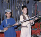 Afghan boys in a gun shop