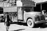 Afghanistan, decorated bus at caravansary in Hindu Kush mountains