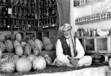 Afghanistan, merchant selling melons and hookahs in Kābul market