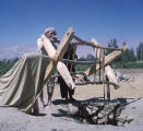 Afghanistan, man drawing water from well