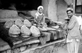 Afghanistan, vendor selling bread at Kābul market