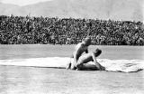 Afghanistan, men wrestling at sports stadium in Kābul