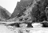 Afghanistan, stone bridge over mountain stream at Dowshi