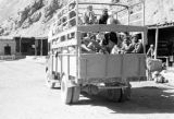 Afghanistan, bus loaded with passengers at caravansary in Hindu Kush mountains