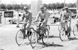 Afghanistan, uniformed men riding bicycles in Kābul