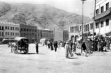 Afghanistan, Kābul street scene with pedestrians and new buildings