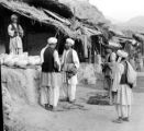Afghanistan, men in front of melon vendor at caravansary