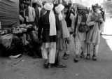 Afghanistan, men walking through Kābul market