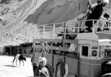 Afghanistan, passengers on bus at caravansary in Hindu Kush mountains