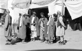 Afghanistan, men gathered at Kābul market