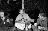 Afghanistan, Harrison Forman smoking hookah with Joe Donohue and other man