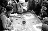 Afghanistan, men at gambling table in Kābul