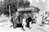 Afghanistan, men gathered around bus