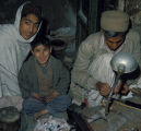 Afghan goldsmith and family
