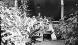 Chile, Robert Platt's family and Rex and Muriel Hales sitting on porch in Santiago