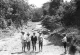 Colombia, row of boys in road near Cafetal Aguilar