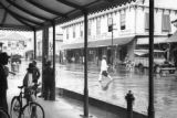 Guyana, sheltering from rain on Water Street in Georgetown