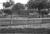 Colombia, view of house through fence at Hacienda El Hatico in Valle del Cauca department