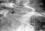 Argentina, aerial view of agriculture and river in valley near Cacheuta