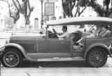 Brazil, Harriet Platt, Mr. Tansley, and Mr. Silva posing with automobile outside Grande Hotel in...