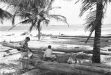 Brazil, making jangadas on beach in Fortaleza