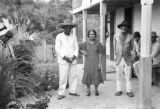 Brazil, owner with wife and father outside house at Fazenda Munezes
