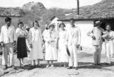 Brazil, Harriet Platt posing with owner's family at Sitio São João