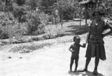 Brazil, children of administrator near garden at Fazenda Boa Sentença