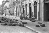 Brazil, moving rubber balls from waterfront street in Belém