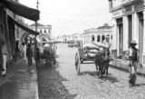Brazil, carts loaded with cocoa on main street in Itabuna