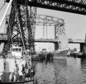 Argentina, ships under Puente Transbordador [La Boca Bridge] at port of Buenos Aires