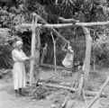 Brazil, people building wooden structure in tropical forest