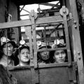 Bolivia, miners in elevator at tin mining facility in Oruro