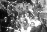 Group portrait of passengers aboard a freighter bound for Africa