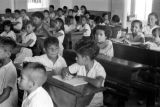 Brazil, school children at desks in Gurupá