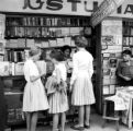 Chile, girls purchasing books from stand in Santiago
