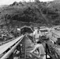 Brazil, men on train ramp at mining site in Betim