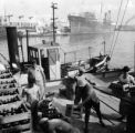 Argentina, dock workers unloading crates at port of Buenos Aires