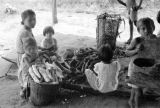 Brazil, family preparing meal outdoors in Gurupá