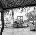 Brazil, man on tractor in village