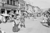 Peru, officer and street vendors at Huancayo marketplace