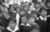 Bolivia, children in crowd watching Lady of Fatima parade in La Paz