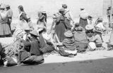 Peru, group of women tying ropes at Sunday market in Huancayo