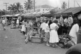 Brazil, people and vending stands at Salvador marketplace