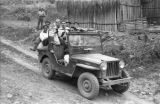 Bolivia, group of men sitting in jeep parked on dirt road in La Paz
