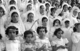 Bolivia, girls dressed in white for Lady of Fatima of Caiconi parade in La Paz