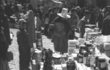 Bolivia, woman in hat looking at items for sale at La Paz market