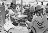 Peru, women weighing coca leaves at Juliaca marketplace