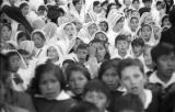 Bolivia, girls in veils watching Lady of Fatima parade in La Paz