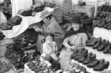 Bolivia, women selling shoes at market in La Paz